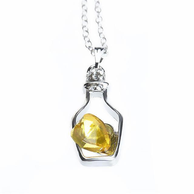 Pendentif/ flacon à parfum forme de coeur