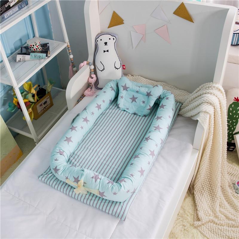 Réducteur & lit bébé portable