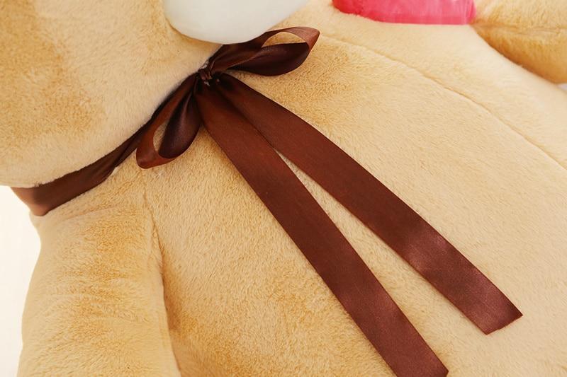 Grosse peluche nounours avec nœud